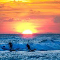 Surfers, Kauai, Hawaii, USA.