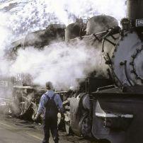 Train, Durango, Colorado; conductorl person; snow; moutain; smoke