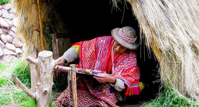 Woman, Awana Kancha Llama Farm, Pisac, Peru