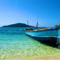 Lone Boat on tropical paradise island Honduras Caribbean
