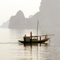Sailing through limestone karst at Halong Bay, Southeast Asia