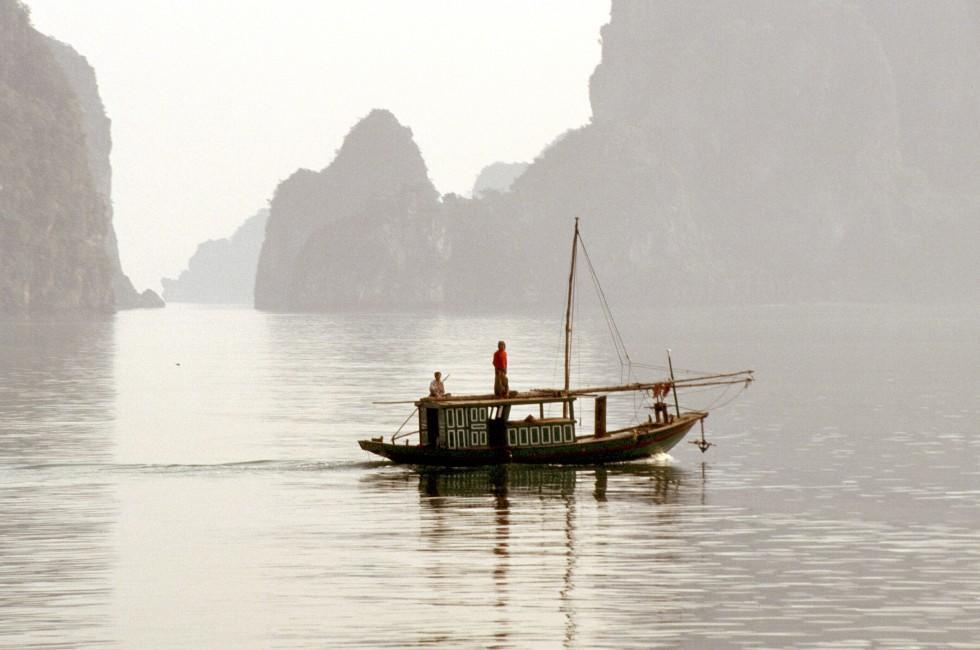 Sailing through limestone karst at Halong Bay, Southeast Asia
