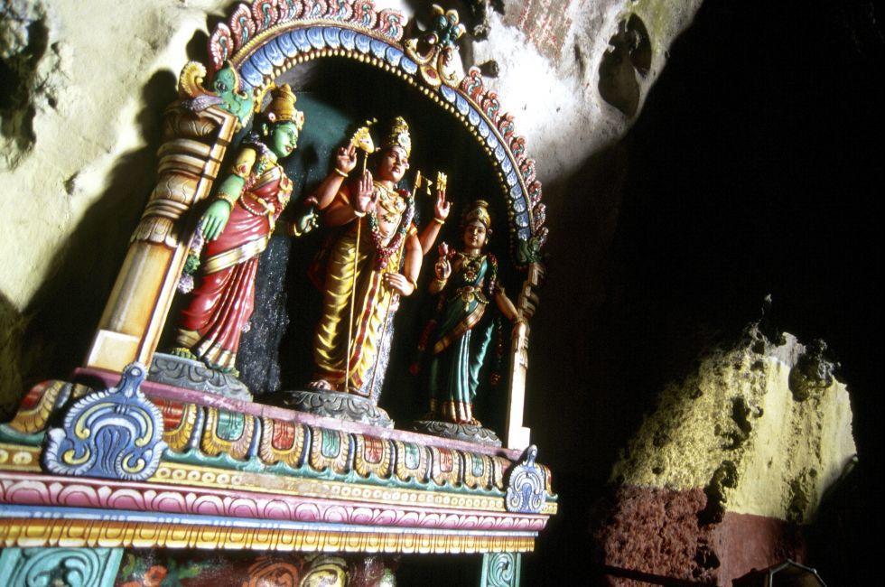 Climbing Hindu pilgrimage to Batu Caves, near Kuala Lampur, Gombak, Malaysia, Asia.
