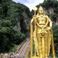 Climbing Hindu pilgrimage to Batu Caves, near Kuala Lampur, Gombak, Southeast Asia