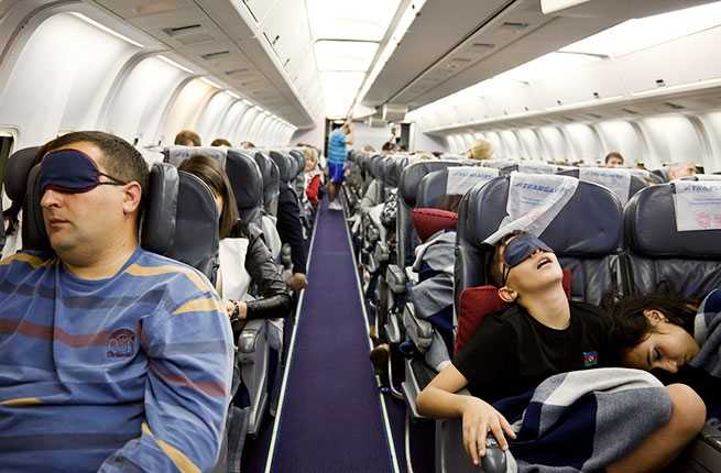 11 Tips & Tricks for Sleeping on Planes