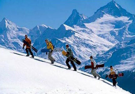 Snowboarders with view of matterhorn