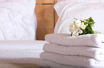 1_hotelroom-bed.jpg