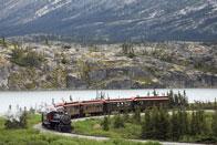 Alaska-Skagway-white-pass-railroad-train-bend-river.jpg