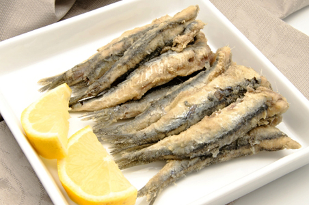... fried anchovies by plate of deep fried anchovies across fresh