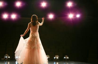 Woman-Performing-On-Stage.jpg