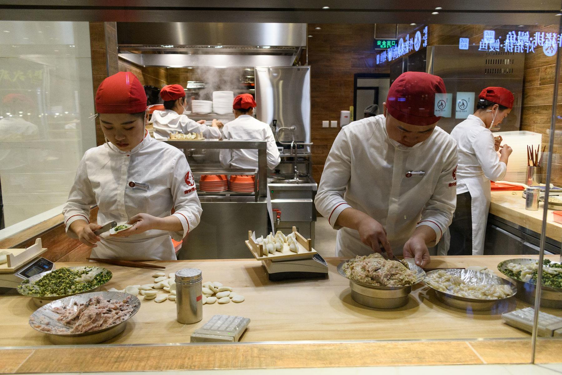 In this Beijing restaurant, chefs make dumplings in front of customers.