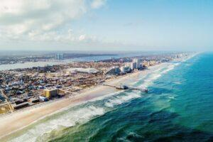 _NeedToKnowFlorida__HERO_daytona-beach-aerial-full-rights-500px1