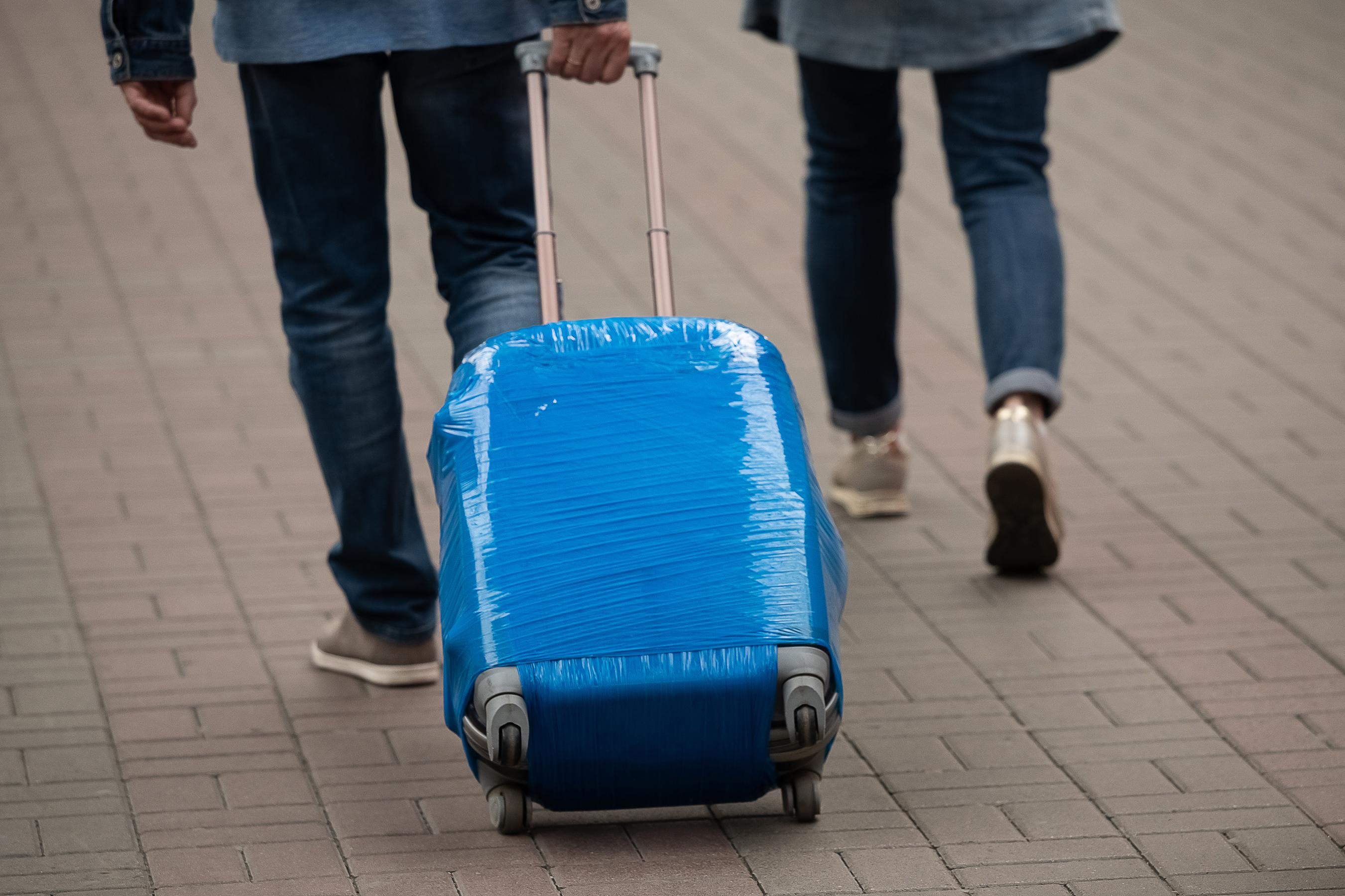 Should You Shrink or Plastic Wrap Your Checked Luggage?