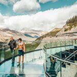 01_Canada__GlacierViewHotel_1.3) PX-Skywalk-Couple-Walking-with-Reflection-Morning