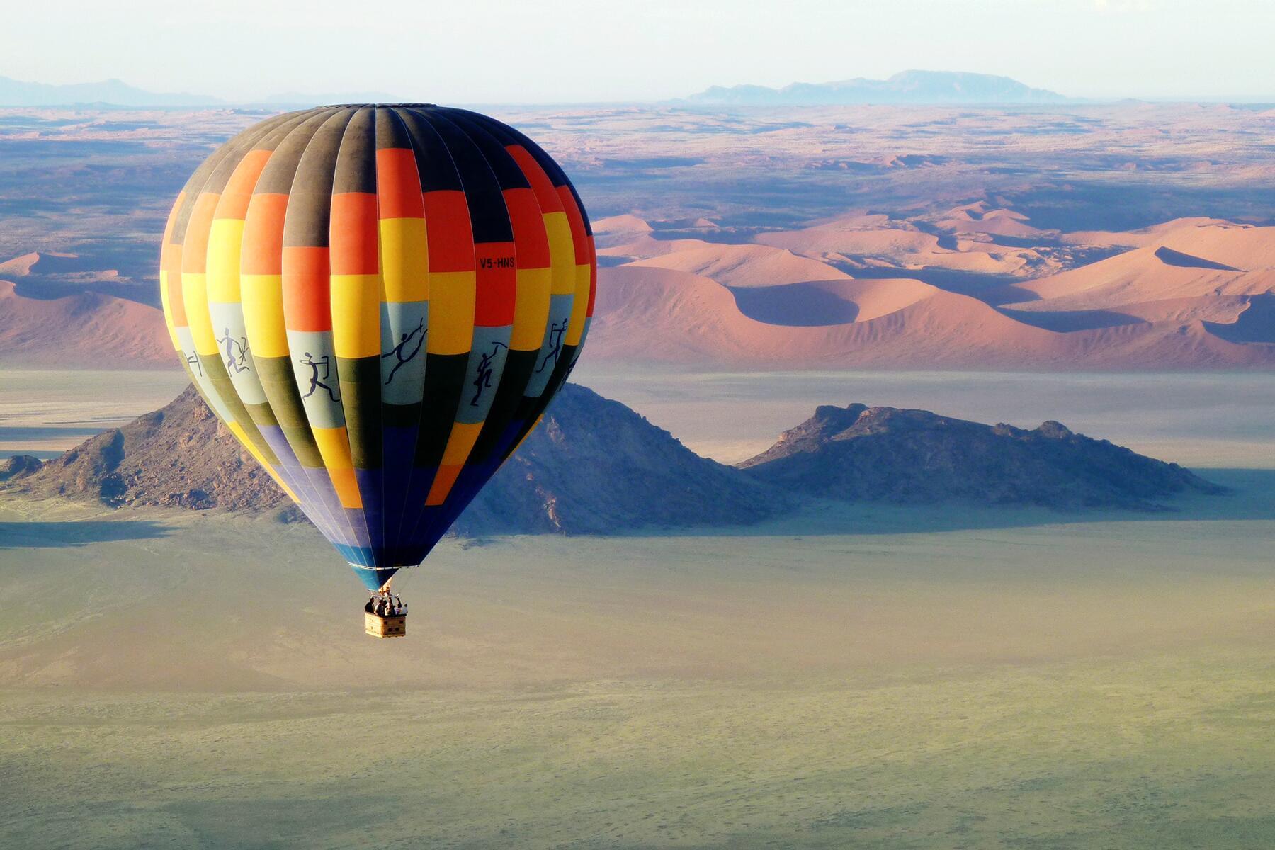 13_UnexpectedHoneymoons__SoarHighAbovetheNamibianDesert_13.) Balloon In Dramatic Landscape